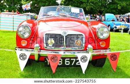 NOTTINGHAM, UK - JUNE 1, 2014: Frontal view of MG (Morris Garages) vintage cars for sale in Nottingham, England. - stock photo