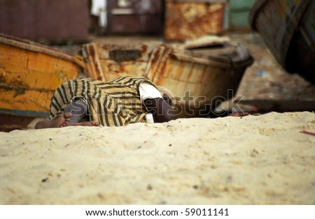 NOUAKCHOTT, MAURITANIA - JAN 5: Local fisherman rests at the beach at January 5, 2006 in Nouakchott, Mauritania. Fishing during all night is quite hard for the locals. - stock photo