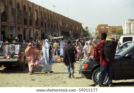 NOUAKCHOTT, MAURITANIA - JAN 5: Local people sell their staff at the market on January 5, 2006 in Nouakchott, Mauritania. The city market is an interesting place to visit. - stock photo