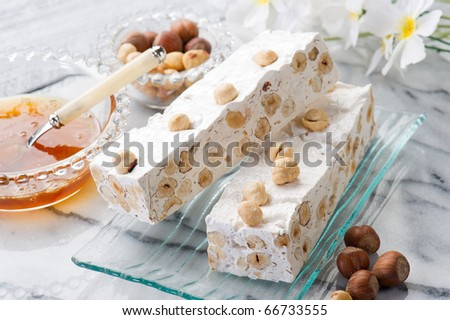 nougat with ingredients on marble table - stock photo