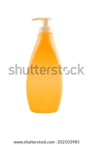 Nourishing body milk bottle with work path. Blank yellow plastic bottle isolated on white background. - stock photo