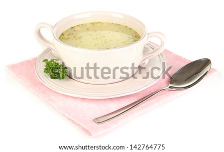 Nourishing soup with vegetables in pan isolated on white - stock photo