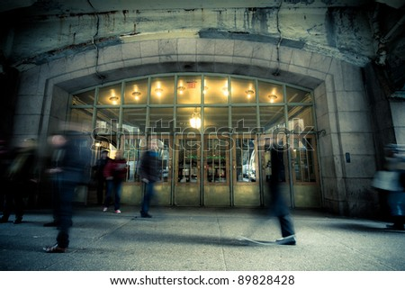 NOV. 3 - NEW YORK CITY:  Commuters pass through the doors at historic Grand Central Terminal in New York City on November 3, 2011. 750,000 people pass through Grand Central daily. - stock photo