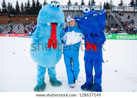 NOVE MESTO NA MORAVE - FEBRUARY 17: Volunteer with official mascots at IBU World Championship in biathlon 2013 in Nove Mesto na Morave 2013, February 17, Czech republic - stock photo