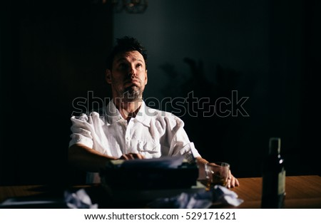 Novelist with writer's block fed up with writing book
