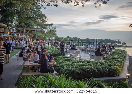 November 25, 2016 at 17.30 hrs., Chonburi, Thailand. Restaurant the skygallery. People eat dinner. And sunset