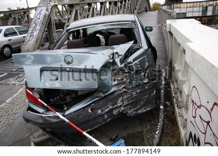 NOVEMBER 2009 - BERLIN: a crashed car at the Bornholmer Bruecke, Berlin-Prenzlauer Berg.