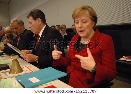 NOVEMBER 21, 2005 - BERLIN: Michael Glos, Chancellor Angela Merkel before a meeting of the parliamentary faction of the Christian Democratic Party in the German Bundestag, Berlin.