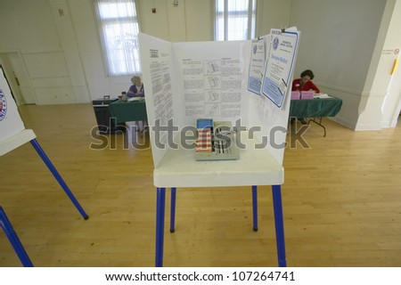 NOVEMBER 2004 - Election volunteers and voting booths in a polling place, CA - stock photo