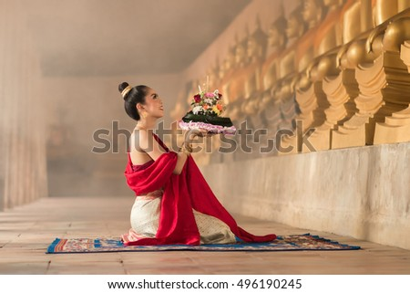 November Full-Moon Beautiful Woman With Kratong Pray of Buddah in ancient Temple
