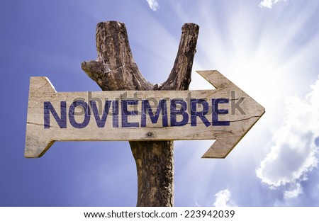 November (In Spanish) wooden sign on a beautiful day - stock photo
