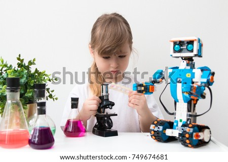November, 2017. Minsk, Belarus. Pretty cute little girl is playing with Lego robot Vernie.  STEM education. Robotics class. Elementary school.