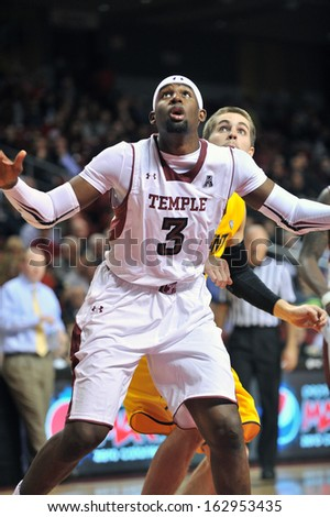 NOVEMBER 11 - PHILADELPHIA: Temple Owls center Anthony Lee (3) blocks out trying for a rebound during the NCAA basketball game against Kent State November 11, 2013 in Philadelphia  - stock photo