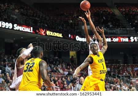 NOVEMBER 11 - PHILADELPHIA: Temple Owls guard Josh Brown (with ball) puts up a contested jump shot during the NCAA basketball game against Kent State November 11, 2013 in Philadelphia  - stock photo