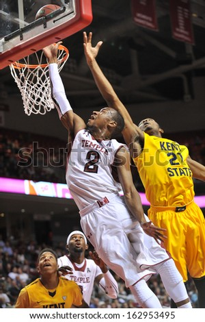 NOVEMBER 11 - PHILADELPHIA: Temple Owls guard Will Cummings (2) puts up a contested shot in the lane during the NCAA basketball game against Kent State November 11, 2013 in Philadelphia  - stock photo