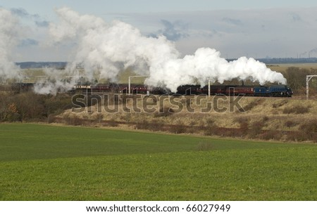 November 2010. Preserved British Railway steam locomotive 60007 'Sir Nigel Gresley' storms away from the Conington water stop and is seen passing Wood Walton, Cambridgeshire, England, UK. - stock photo