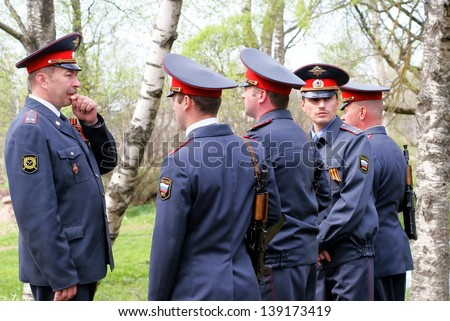 NOVGOROD REGION, RUSSIA - MAY 9: Unknown police conducts training on protection of public order on streets rural settlement Bolshaya Vishera, Novgorod region, Russia. May 9, 2010.  - stock photo