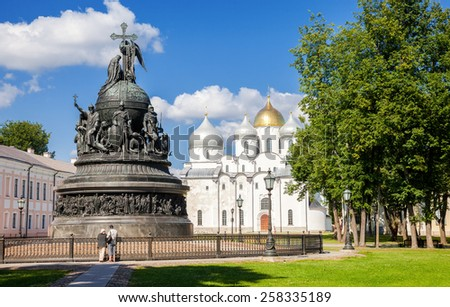 NOVGOROD, RUSSIA - JULY 24, 2014: Bronze monument for Millennium of Russia and St. Sophia cathedral in the Novgorod Kremlin. The monument was unveiled on 1862. Sculptors M. Mikeshin and I. Shreder - stock photo