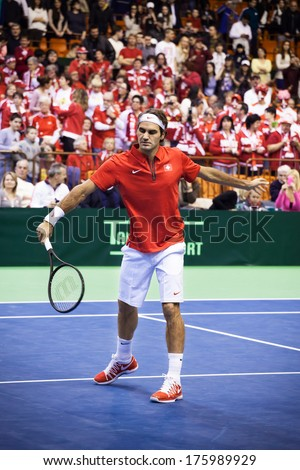 NOVI SAD - JANUARY 31: ROGER FEDERER of Switzerland and  during the Davis Cup match between Serbia and Switzerland, January 31 2014, Novi Sad, Serbia - stock photo