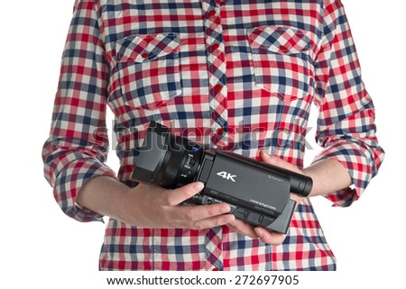 NOVI SAD, SERBIA - APRIL 25, 2015: Person holding Sony FDR AX100, 4k UHD Handycam Camcorder captures Ultra High Definition Footage. Illustrative editorial for product isolated on white background. - stock photo