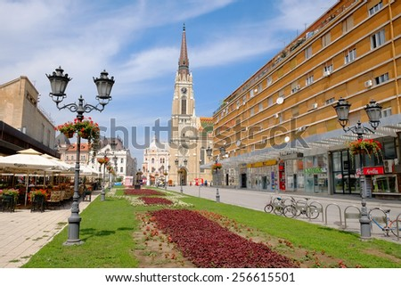 NOVI SAD, SERBIA - AUGUST 03: old style street light and the Catholic Cathedral in main square of Novi Sad. Shot in 2014  - stock photo