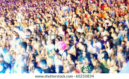 NOVI SAD, SERBIA - CIRCA JULY 2010:Motion blur of audience in front of the Dance Stage at the Best European Music Festival - EXIT 2010, circa July 2010 at the Petrovaradin Fortress in Novi Sad. - stock photo