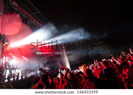NOVI SAD, SERBIA - JULY 10: Audience and rain infront of the Main Stage at EXIT 2013 Music Festival, during Viva Vox's performance on July 10, 2013 in the Petrovaradin Fortress in Novi Sad.  - stock photo
