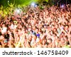 NOVI SAD, SERBIA - JULY 11: Audience in front of the Dance Arena at EXIT 2013 Music Festival, during Fat Boy Slim's performance on July 11, 2013 in the Petrovaradin Fortress in Novi Sad. (motion blur) - stock photo
