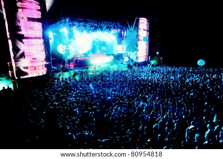 NOVI SAD, SERBIA - JULY 7: Audience in front of the Dance Arena at EXIT 2011 Music Festival, during DEADMAUS5 performance, on July 7, 2011 in the Petrovaradin Fortress in Novi Sad. - stock photo