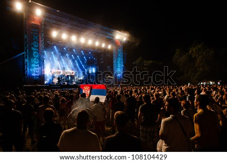 NOVI SAD, SERBIA - JULY 12: Audience in front of the Main Stage at EXIT 2012 Music Festival, during Skindred's performance on July 12, 2012 in the Petrovaradin Fortress in Novi Sad.