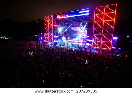 NOVI SAD, SERBIA - JULY 11: Audience infront of the Dance Arena at EXIT 2014 Music Festival, during Carl Cox's performance on July 11, 2014 in the Petrovaradin Fortress in Novi Sad. - stock photo