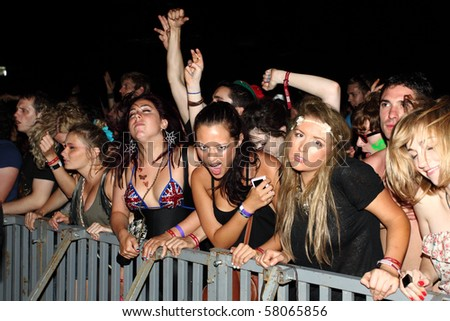 NOVI SAD, SERBIA - JULY 8: Audience infront of the Main Stage at the Best European Music Festival - EXIT 2010, on July 8, 2010 in the Petrovaradin Fortress in Novi Sad. - stock photo