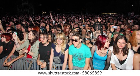 NOVI SAD, SERBIA - JULY 9: Audience infront of the Main Stage at the Best European Music Festival - EXIT 2010, on July 9, 2010 in the Petrovaradin Fortress in Novi Sad. - stock photo