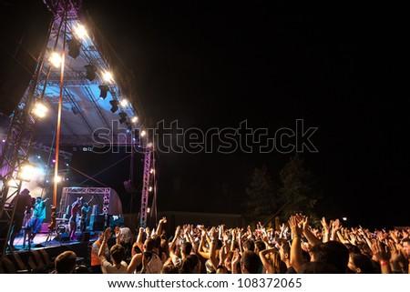 NOVI SAD, SERBIA - JULY 15: The Fusion Stage at EXIT 2012 Music Festival, during Buraka Som Sistema's performance on July 15, 2012 in the Petrovaradin Fortress in Novi Sad. - stock photo