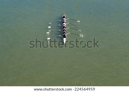NOVI SAD, SERBIA - OCTOBER 18, 2014: Aerial Top View of Eight men rowing kayak on Danube River in Novi Sad on traditional remote regatta competition. - stock photo