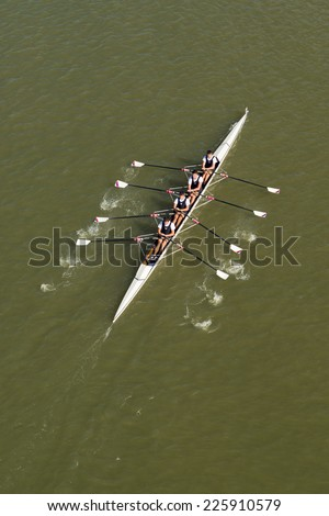 NOVI SAD, SERBIA - OCTOBER 18, 2014: Aerial Top View of Four men rowing on Danube River in Novi Sad on traditional remote regatta competition. - stock photo