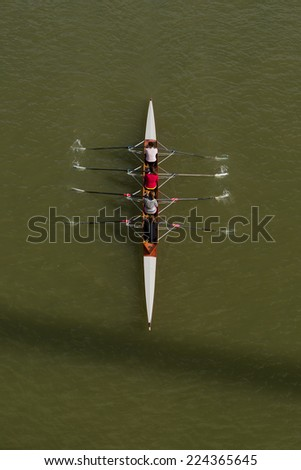 NOVI SAD, SERBIA - OCTOBER 18, 2014: Aerial Top View of Four women rowing on Danube River in Novi Sad on traditional remote regatta competition. - stock photo