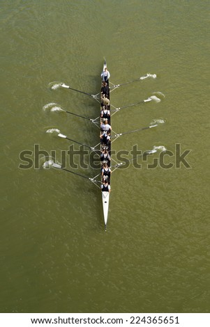 NOVI SAD, SERBIA - OCTOBER 18, 2014: Eight men rowing on Danube River in Novi Sad on traditional remote regatta competition. - stock photo