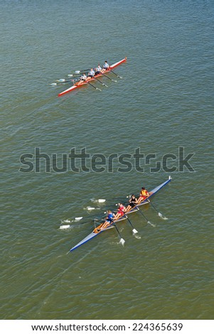 NOVI SAD, SERBIA - OCTOBER 18, 2014: Men rowing on Danube River in Novi Sad on traditional remote regatta competition. - stock photo