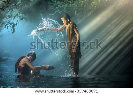 Novice buddhist monk splashing.