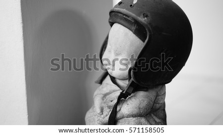 Novice statue wearing black helmet, focus on right eye, black and white process