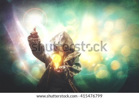 novice warlock making a spell of a small fireball - stock photo
