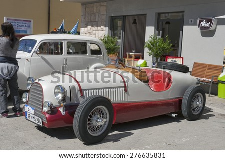 NOVIGRAD, CROATIA - SEPTEMBER 13, 2014: Unrecognizable people look around Jaguar SS and other vintage cars on 5th International Old Timer Car Rally. Event organized by club Eppur si muove from Umag. - stock photo