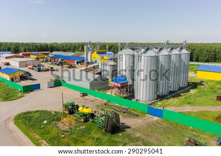 "Novikova, Russia - June 18, 2015: Aerial view onto modern machine yard of agricultural firm ""Russian Field"". Tyumen region - stock photo"