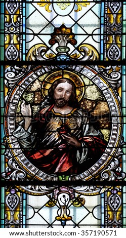 NOVO MESTO, SLOVENIA - JUNE 30: Sacred heart of Jesus, stained glass window in Cathedral of St Nicholas in Novo Mesto, Slovenia on June 30, 2015 - stock photo