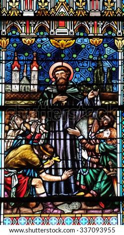 NOVO MESTO, SLOVENIA - JUNE 30: Stained glass window in Cathedral of St Nicholas in Novo Mesto, Slovenia on June 30, 2015 - stock photo