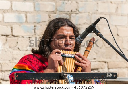 Novocherkassk, Rostov region, RUSSIA - APRIL 9, 2009: Street musician from Peru performing Latin music