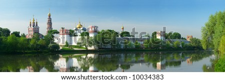Novodevichy convent in the early morning (view from the lake) - stock photo