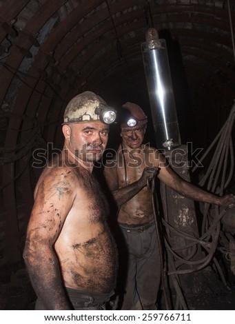 "Novogrodovka, Ukraine - January, 18, 2013: The miners in the mine ""1/3 Novogrodovskaya"" at a depth of 800 meters below ground - stock photo"