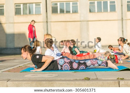 Novokuznetsk, Kemerovo region, Russia - 06 June 2014: People participating in the free public Yoga class in summer at Park, Novokuznetsk, 06 June 2014.